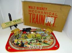 1950's NEAR MINT COMPLETE WALT DISNEY MECHANICAL TRAIN SET BY MARX-BEAUTIFUL